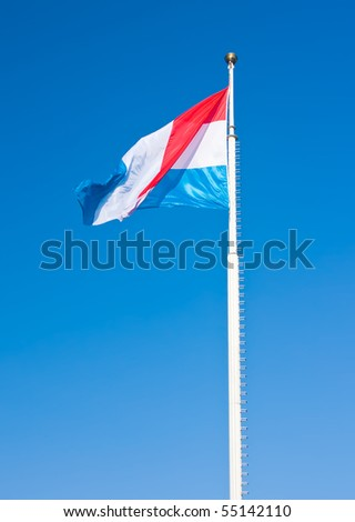 Flag of Luxembourg over blue sky. This photo is taken in Luxembourg