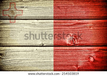 Flag of Malta painted on old grungy wooden  background