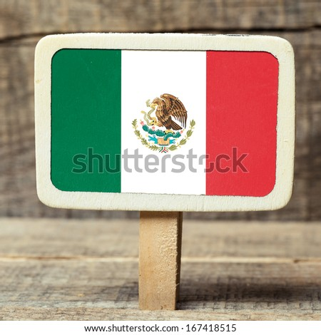 Flag of Mexico on Small wooden framed blackboard on wooden background