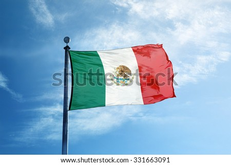 Flag of Mexico on the mast - stock photo
