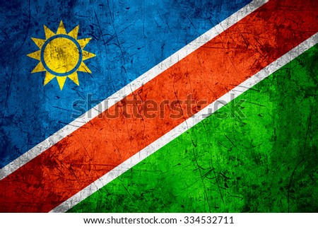 flag of Namibia or Namibian banner on rough pattern metal background