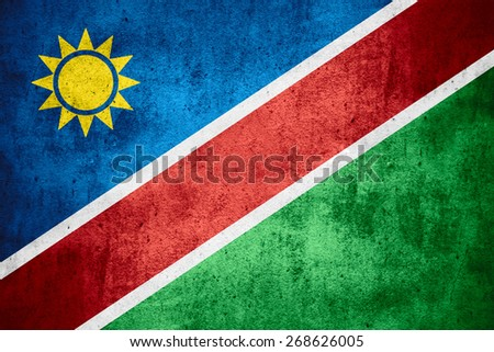 flag of Namibia or Namibian banner on rough pattern texture background