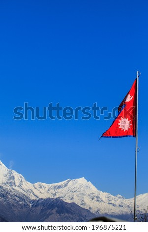 Flag of Nepal waving with himalayan view, Poon Hill, Nepal  - stock photo