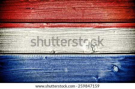 flag of Netherlands painted on old grungy wooden  background - stock photo