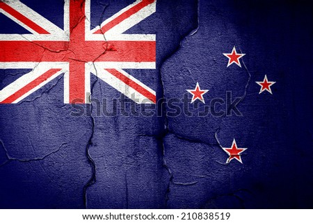 flag of New Zealand painted on cracked wall - stock photo