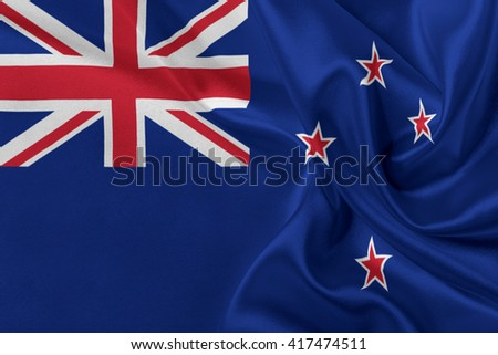 Flag of New Zealand waving in the wind. - stock photo