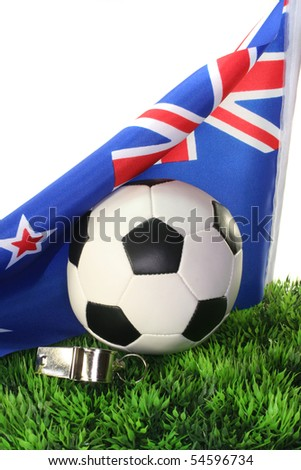 Flag of New Zealand with soccer in a field