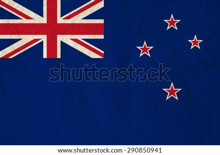 Flag of New Zealand with vintage old paper - A Blue Ensign defaced with four stars of the Crux Australis in red, outlined in white. - stock photo