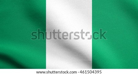 Flag of Nigeria waving in the wind with detailed fabric texture. Nigerian national flag.