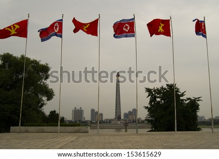 Flag of North Korea and flag of the Workers' Party of Korea. The center of Pyongyang - the capital of North Korea. - stock photo