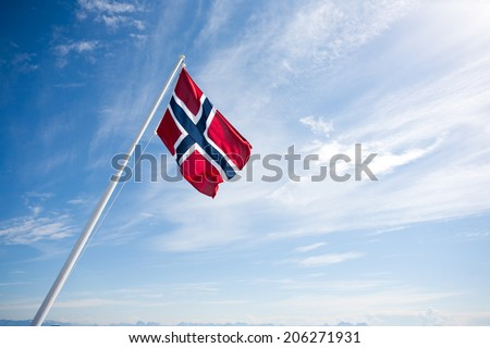 Flag of Norway on blue sky background. - stock photo