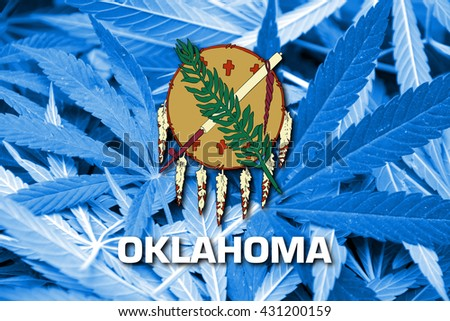 Flag of Oklahoma State, on cannabis background. Drug policy. Legalization of marijuana - stock photo