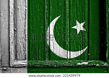 flag of Pakistan painted on wooden frame - stock photo
