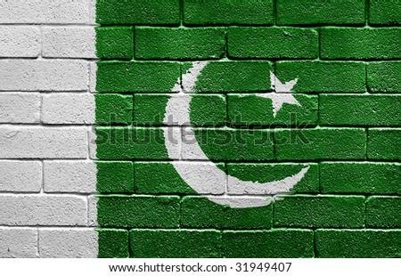 Flag of Pakistan painted onto a grunge brick wall - stock photo