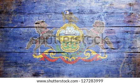 Flag of Pennsylvania painted on grungy wooden background - stock photo