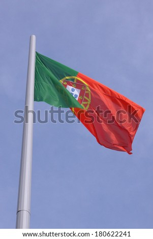 flag of Portugal over blue sky
