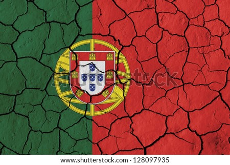 Flag of Portugal over cracked background, conceptual image of crisis - stock photo