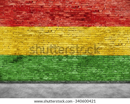 Flag of reggae music painted over brick wall - stock photo