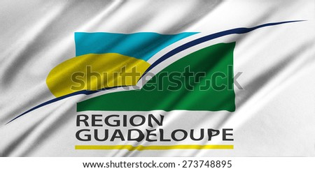 Flag of Region Guadeloupe waving in the wind - stock photo