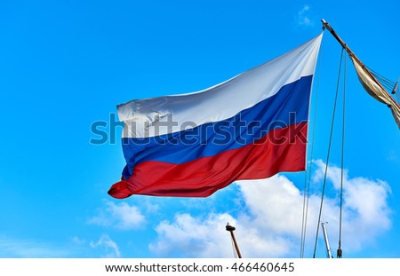 Flag of Russia against blue sky
