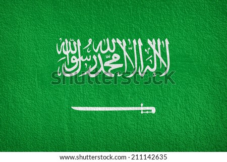 Flag of Saudi Arabia painted onto a grunge wall  - stock photo