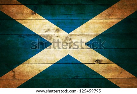 Flag of Scotland painted on grungy wood plank background - stock photo