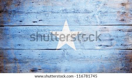 Flag of Somalia painted on grungy wood plank background - stock photo