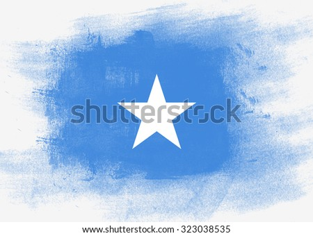 Flag of Somalia painted with brush on solid background, - stock photo