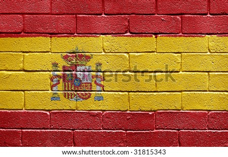 Flag of Spain painted onto a grunge brick wall - stock photo