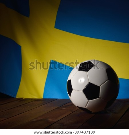 Flag of Sweden with football on wooden boards as the background. MANY OTHER PHOTOS FROM THIS SERIES IN MY PORTFOLIO. - stock photo