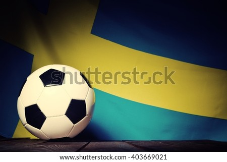 Flag of Sweden with football on wooden boards as the background. Vintage Style. - stock photo
