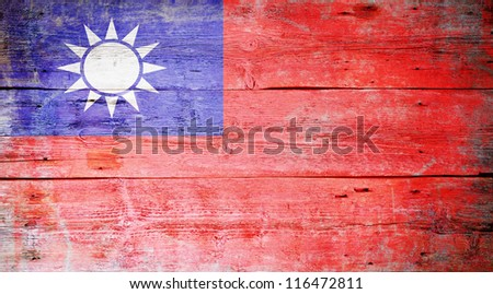 Flag of Taiwan painted on grungy wood plank background - stock photo