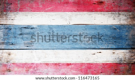 Flag of Thailand painted on grungy wood plank background - stock photo