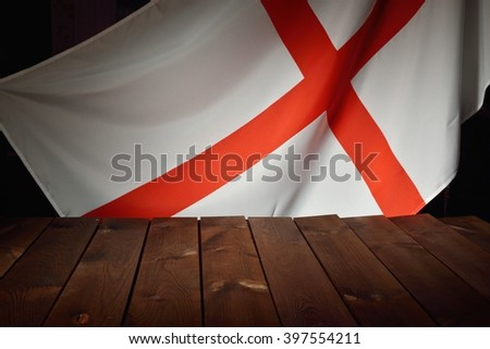 Flag of the England with wooden boards as a background. MANY OTHER PHOTOS FROM THIS SERIES IN MY PORTFOLIO. - stock photo