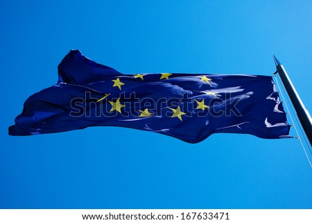Flag of the European Union against the blue sky - stock photo