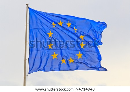 Flag of the European Union with flag pole waving in the wind - stock photo