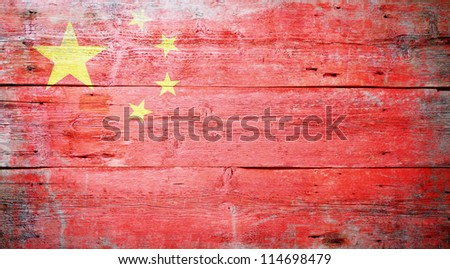 Flag of the People's Republic of China painted on grungy wood plank background - stock photo