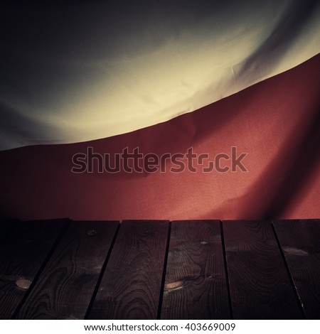 Flag of the Poland with wooden boards as a background. Vintage Style. - stock photo