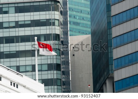 Flag of the Republic of Singapore against office windows - stock photo