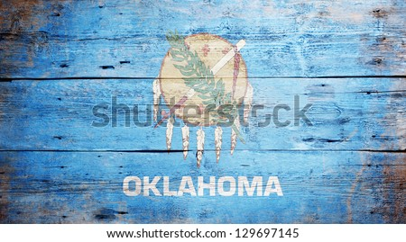Flag of the state of Oklahoma painted on grungy wooden background - stock photo