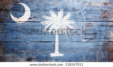 Flag of the state of South Carolina painted on grungy wooden background - stock photo
