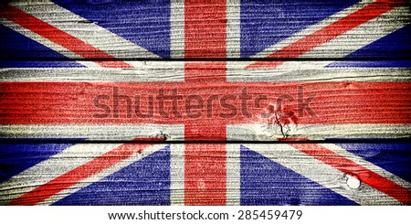 Flag of the United Kingdom painted on old grungy wooden  background