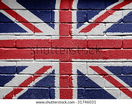 Flag of the United Kingdom painted onto a grunge brick wall - stock photo