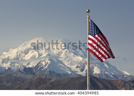 Flag of the United States in front of Mt. Denali, Alaska - stock photo