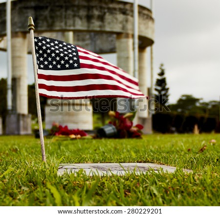 Flag of the United States of America on grave marker in cemetary - stock photo