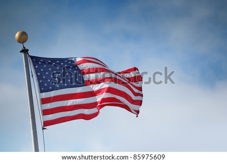 Flag of the United States of America over blue sky background - stock photo
