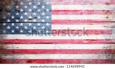 Flag of the United States of America painted on grungy wood plank background - stock photo