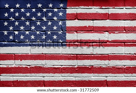 Flag of the United States of America painted onto a grunge brick wall