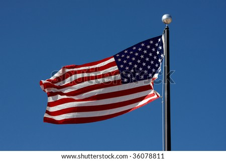 Flag of the USA waving in the wind - stock photo