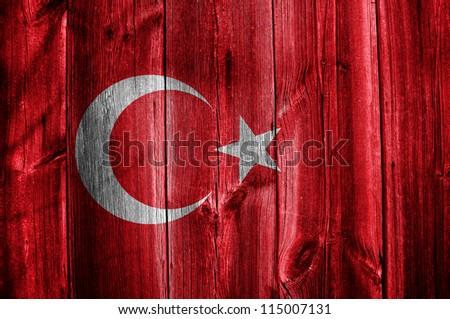 Flag of Turkey painted on grungy wood plank background - stock photo